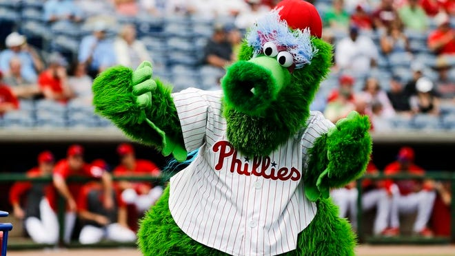 From Feb. 25, 2020, The Phillie Phanatic mascot performs before a spring training baseball game against the Toronto Blue Jays in Clearwater, Fla. Mascots have no other place in baseball should the sport resume. Mascots will be banned. Take a look across the globe and mascots remained a staple of baseball games in Taiwan and the KBO League in South Korea.