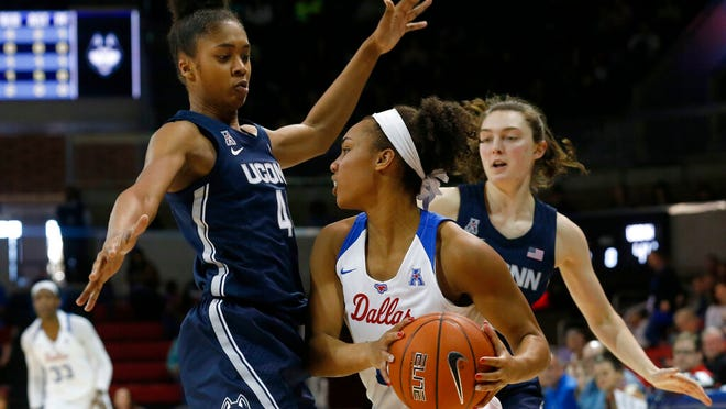 Connecticut guards Aubrey Griffin (44) and Molly Bent, right, defend against SMU guard Reagan Bradley (13) during the first half of an NCAA college basketball game in University Park, Texas, Sunday, Jan. 5, 2020.