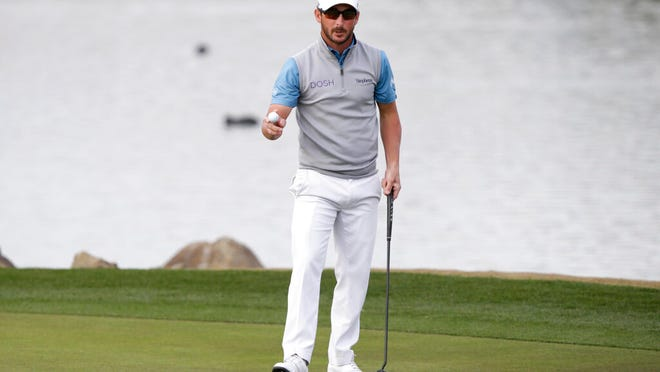 Andrew Landry reacts after a birdie putt on the 18th hole to win The American Express golf tournament on the Stadium Course at PGA West in La Quinta, Calif., Sunday, Jan. 19, 2020.