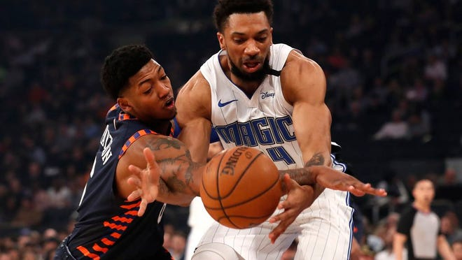 Orlando Magic center Khem Birch, right, is fouled by Knicks guard Elfrid Payton, left, during the first half.