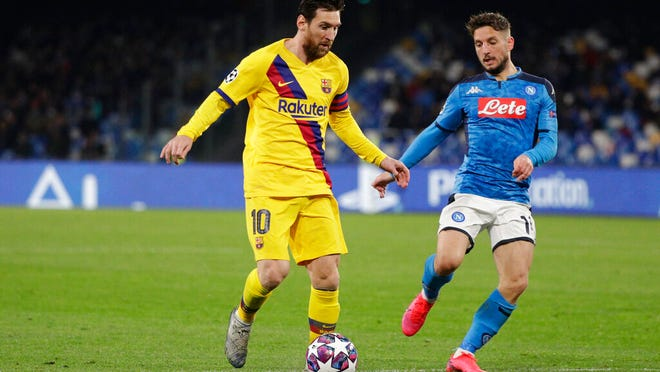 Barcelona's Lionel Messi, left, and Napoli's Dries Mertens challenge for the ball during the Champions League, Round of 16, first-leg soccer match between Napoli and Barcelona, at the San Paolo Stadium in Naples, Italy, Tuesday, Feb. 25, 2020.
