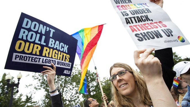 In this Oct. 8, 2019, file photo, transgender woman Alison Gill, from Maryland, joins supporters of the LGBT gather in front of the U.S. Supreme Court in Washington.  (AP Photo/Manuel Balce Ceneta)