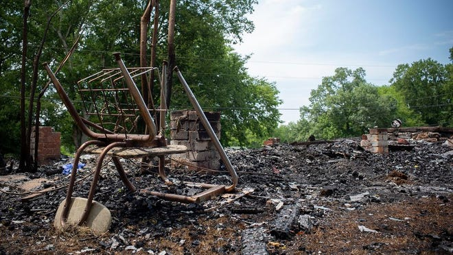 The charred remains of a school desk rests in the ashes of the Canaan School, a historic pre-intergration schoolhouse for Black students in Maury County, Tenn., after the structured was flattened in a fire on Sunday, July 5, 2020.