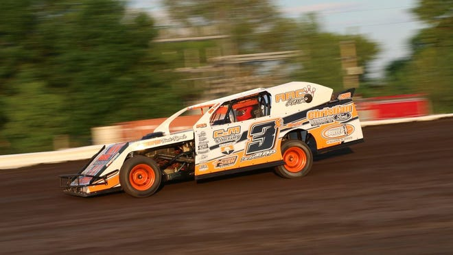 Andy Wagner of Ada races toward his first victory of the season at Norman County Raceway.