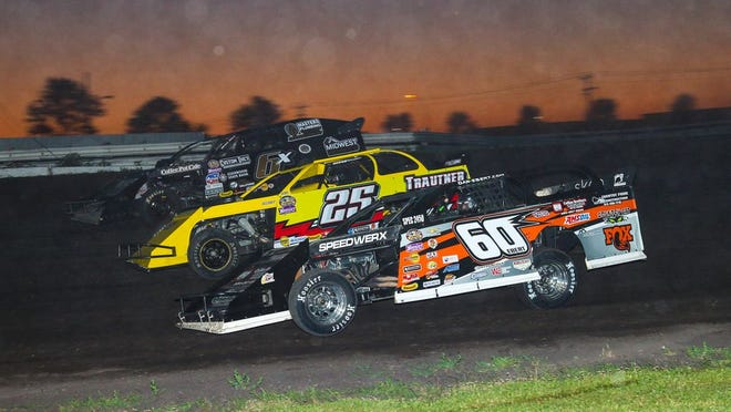 Dan Ebert (60) races with Jamie Trautner of Hendrum, Minn. (25) and Zach Johnson of Lowry, Minn. during the WISSOTA Modified feature.