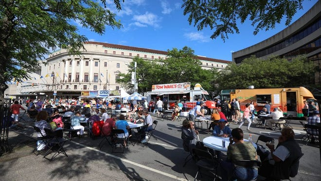 Opening night of a recent CGI Rochester International Jazz Festival sees Main Street full of people eating and enjoying the weather.