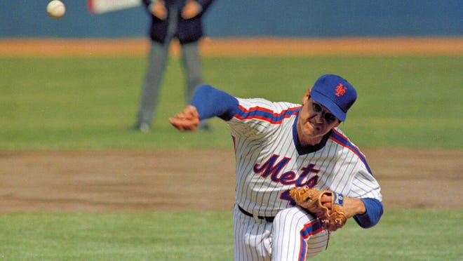 Shown in this April 5, 1983, file photo, New York Mets pitcher Tom Seaver throws against the Philadelphia Phillies during an Opening Day baseball game at Shea Stadium in New York. Seaver pitched for the Mets from 1967-77 and again in 1983.