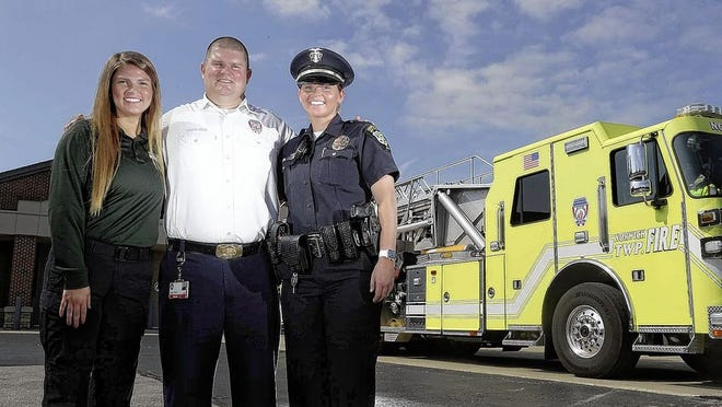 The Warren family members have gravitated toward careers in emergency services. Jeff Warren is chief of the Norwich Township Fire Department, daughter Megan Warren is a dispatcher for the Northwest Regional Emergency Communications Center in Dublin and daughter Kara Warren is a new Grove City Division of Police officer. They are pictured July 21 outside the Joint Safety Services Building in Hilliard.