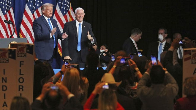 President Donald Trump and Vice President Mike Pence give a thumbs up after speaking during the first day of the Republican National Convention Monday in Charlotte, N.C.