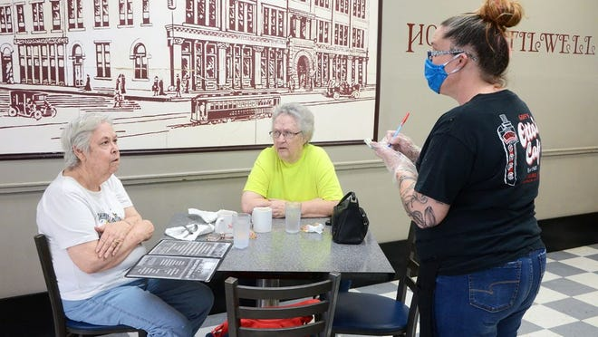 Otto's employees have taken extra precautions when serving customers wearing gloves and masks.
