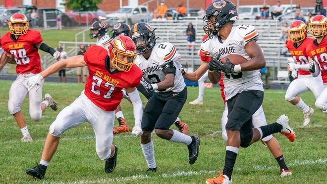 Big Walnut's Lane Pritchard closes in on Delaware's Alex Blevins during their game Aug. 28.