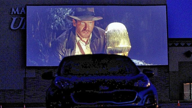 "Marcus Pickerington Cinema is offering ""drive-in"" movies on a 42-foot screen in the parking lot of the theater at 1776 Hill Road North. A double feature that included ""Raiders of the Lost Ark"" was screened June 24."