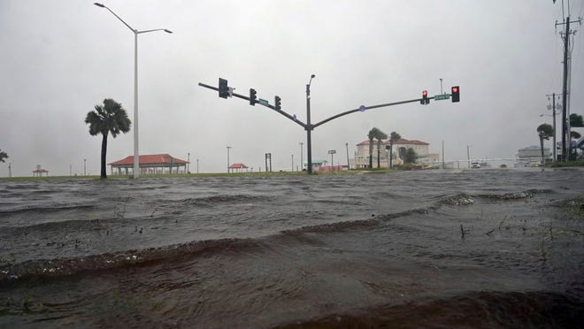 A storm surge covers U.S. 90 in Long Beach, Miss., on the Mississippi Gulf Coast as Tropical Storm Cristobal makes landfall Sunday, June 7, 2020.