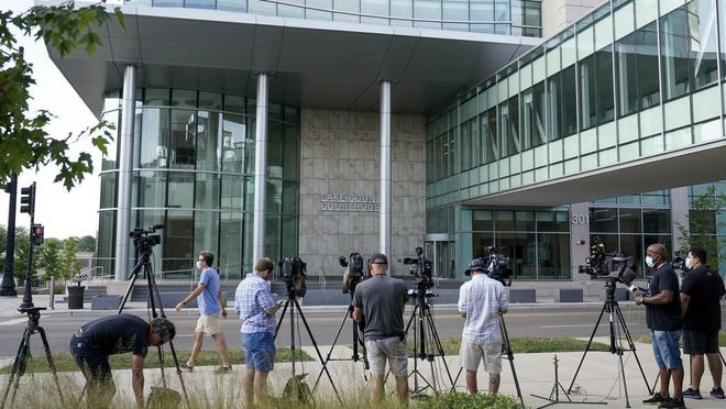 TV cameras set up outside the Lake County courthouse for the extradition hearing for Kyle Rittenhouse Friday, Aug. 28, 2020, in Waukegan, Ill. Prosecutors have charged the 17-year-old from Illinois in the fatal shooting of two protesters in Kenosha, Wis, and the wounding of a third during violent demonstrations over Sunday's police shooting of Jacob Blake.