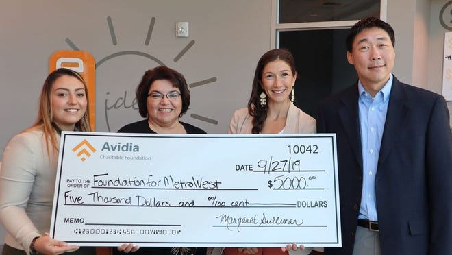 From left, Tracey Tavares, teller for Avidia Bank; Margaret Sullivan, chief financial officer for Avidia Bank; Ayla Walker, senior development officer, corporate engagement for Foundation for MetroWest, and Jay Kim, chief operating officer for Foundation for MetroWest.