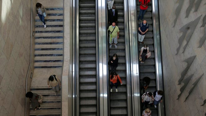 In this photo taken Wednesday, June 24, 2020, commuters leave Lisbon's Rossio train station. Portugal avoided the dramatic numbers of infections and deaths recorded by some other European Union countries during the early months of the coronavirus outbreak but since ending its state of emergency and lockdown at the end of April, its total of officially recorded new infections has remained stubbornly high.