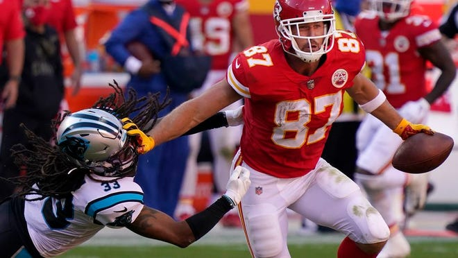 Kansas City Chiefs tight end Travis Kelce (87) runs against Carolina Panthers free safety Tre Boston (33) during the second half of an NFL football game in Kansas City, Mo., Sunday, Nov. 8, 2020.