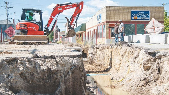 Construction crews make progress on digging work near the Eldon intersection of E 3rd St. and S Mills St.