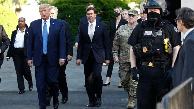 FILE - In this June 1, 2020, file photo President Donald Trump departs the White House to visit outside St. John's Church in Washington.