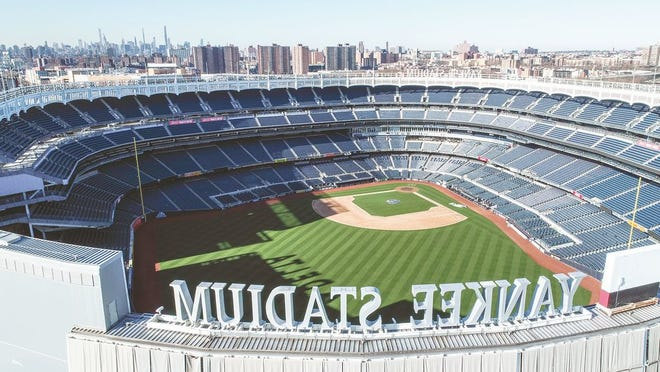This March 26, 2020 file photo shows an empty Yankee Stadium on opening day due to COVID-19 coronavirus restrictions in the Bronx borough of New York.