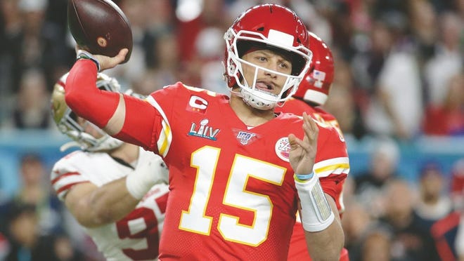 In this Feb. 2, 2020, file photo, Kansas City Chiefs quarterback Patrick Mahomes (15) passes against the San Francisco 49ers during the first half of the NFL Super Bowl 54 football game in Miami Gardens, Fla.