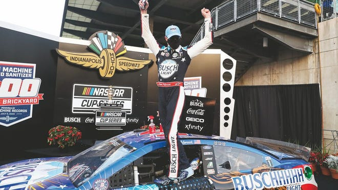 Race driver Kevin Harvick celebrates after winning the NASCAR Cup Series auto race at Indianapolis Motor Speedway in Indianapolis, Sunday, July 5, 2020.