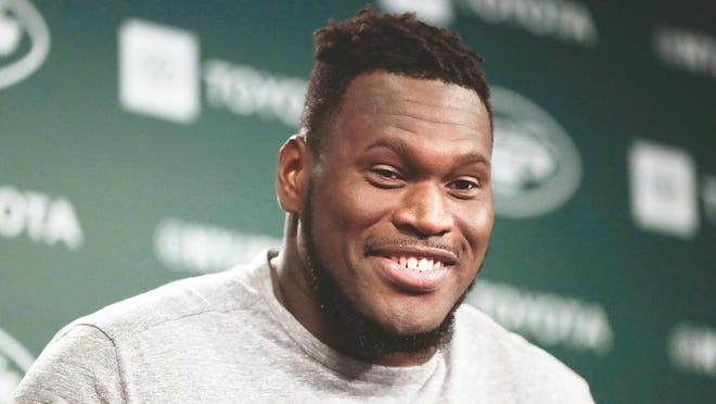 In this June 4, 2019, file photo, New York Jets offensive guard Kelechi Osemele speaks to reporters at the team's NFL football training facility in Florham Park, N.J.
