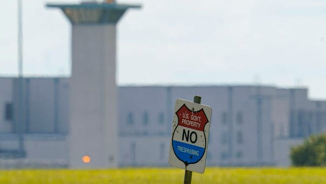A No Trespassing sign stands in front the federal prison complex in Terre Haute, Ind., Wednesday, Aug. 26, 2020. A judge in Washington is halting for now the government's planned Friday execution at the federal prison in Terre Haute, Indiana of Keith Dwayne Nelson who was convicted of kidnapping, raping and murdering at 10-year-old Kansas girl.