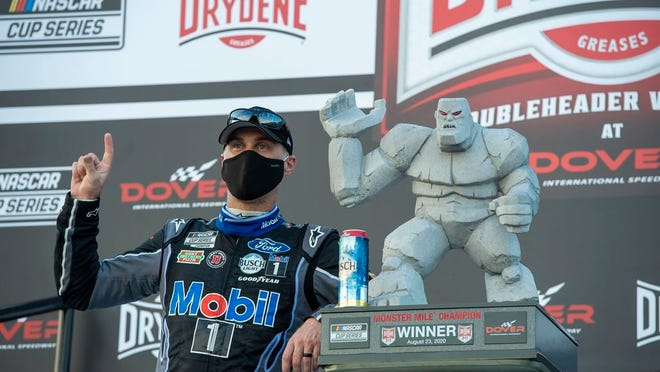 Kevin Harvick celebrates after winning a NASCAR Cup Series auto race at Dover International Speedway, Sunday, Aug. 23, 2020, in Dover, Del.