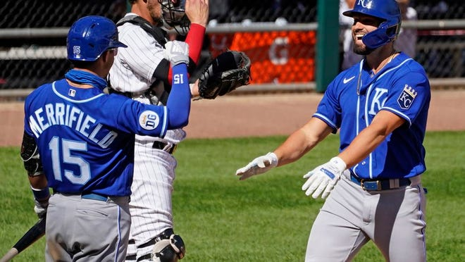 Kansas City Royals' Ryan McBroom, right, smiles as he celebrates with Whit Merrifield after hitting a solo home run during the seventh inning of a baseball game against the Chicago White Sox in Chicago, Saturday, Aug. 29, 2020.
