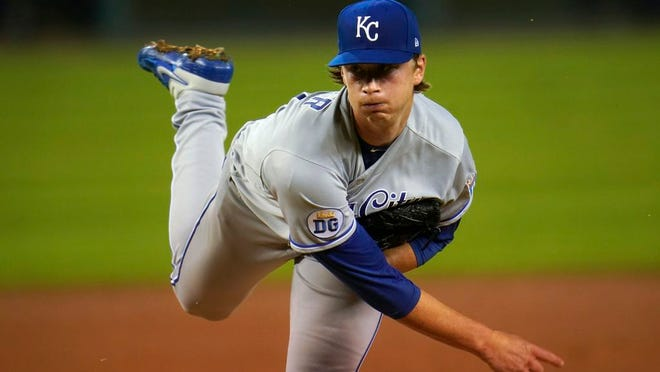 Kansas City Royals pitcher Brady Singer throws against the Detroit Tigers in the fifth inning of a baseball game in Detroit, Wednesday, Sept. 16, 2020.
