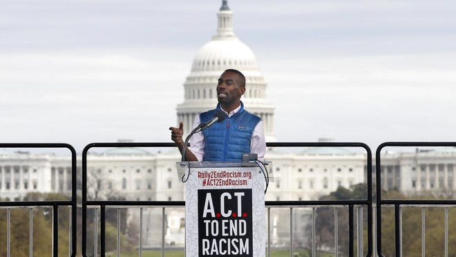 Activist DeRay Mckesson speaks at the A.C.T. To End Racism rally, Wednesday, April 4, 2018, on the National Mall in Washington, on the 50th anniversary of Martin Luther King Jr.'s assassination.