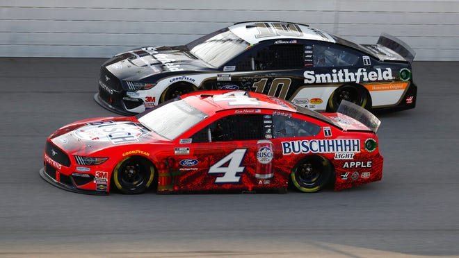 Kevin Harvick (4) races Aric Almirola (10) during the NASCAR Cup Series auto race at Michigan International Speedway in Brooklyn, Mich., Sunday, Aug. 9, 2020.