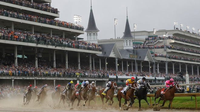 FILE - In this Saturday, May 4, 2019 file photo, Flavien Prat on Country House, third from right, races against Luis Saez on Maximum Security, right, during the 145th running of the Kentucky Derby horse race at Churchill Downs in Louisville, Ky. Maximum Security finished first but was disqualified. The fastest two minutes in sports will also be the quietest in Kentucky Derby history. Churchill Downs scraped plans earlier this month for 23,000 physically distanced, masked fans to attend Saturday's rescheduled Tripled Crown race due to the rise in coronavirus cases. It will be the first time spectators will not be allowed to attend the race.