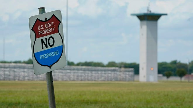 In this Aug. 28, 2020, file photo, a no trespassing sign is displayed outside the federal prison complex in Terre Haute, Ind. A newly released report says the U.S. government for the first time has carried out more civil executions in a year than all states combined as President Donald Trump oversaw a resumption of federal executions after a 17-year pause.