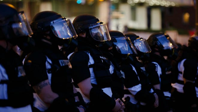 Columbus Division of Police officers stand in formation during protests Downtown on May 29.