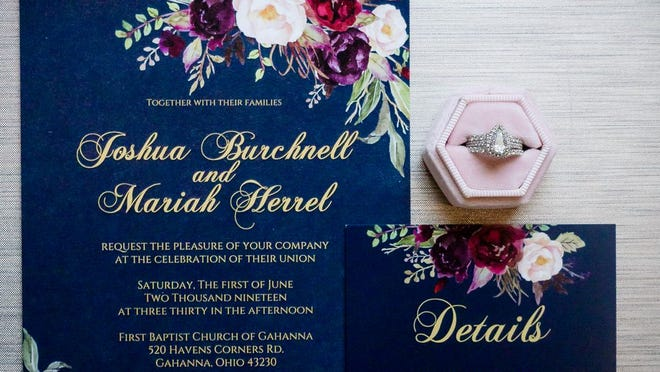 Mariah and Josh Burchnell hired a freelance designer to create their invitations' modern floral motif.