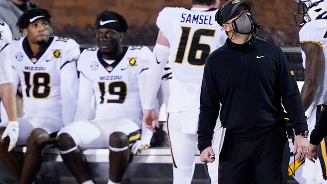 Missouri head coach Eliah Drinkwitz, right, looks at the scoreboard in the second half of an NCAA college football game against Mississippi State, Saturday, Dec. 19, 2019, in Starkville, Miss.