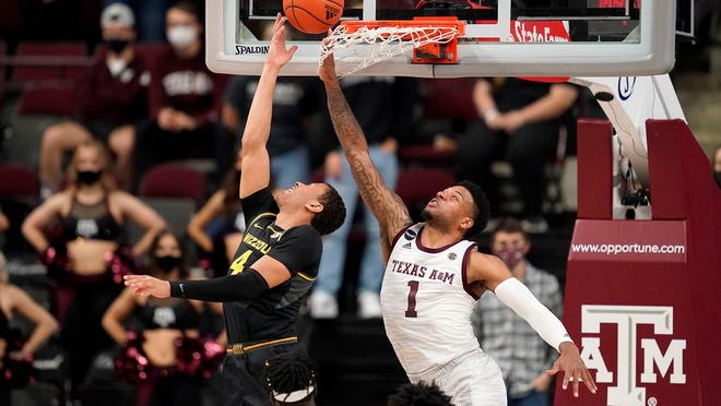 Missouri guard Javon Pickett (4) makes a basket as Texas A&M guard Savion Flagg (1) defends during the second half of an NCAA college basketball game Saturday, Jan. 16, 2021, in College Station, Texas.