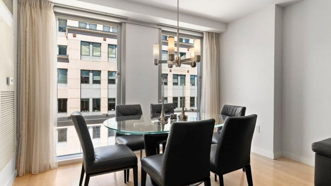 The open dining area has a nice city view. Its chandelier is elegant and contemporary.