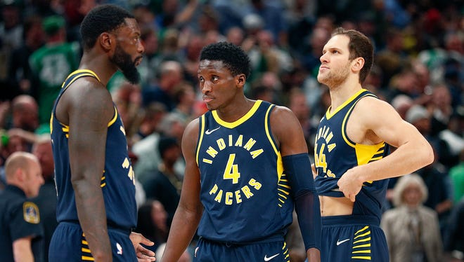 Dejected Indiana Pacers Lance Stephenson,left, Victor Oladipo and Bojan Bogdanovic following loss to the Boston Celtics at Bankers Life Fieldhouse Monday, December 18, 2017. The Boston Celtics defeated the Indiana Pacers 112-111.