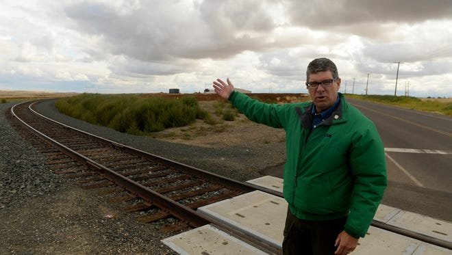 Great Falls Development Authority President Brett Doney stands where a new rail spur crossing 18th Avenue North. The 1,000-foot spur heads east, serving lots at the new Great Falls AgriTech Park.