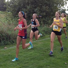 Cleary University's Elaine Lowe (left) placed 38th in 22:48 over 6 kilometers at the Spartan Invitational cross country meet at Forest Akers East Golf Course.