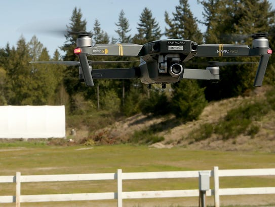The Kitsap County Sheriff's Office drone hovers above the parking lot at the Kitsap County Fairgrounds on Thursday.