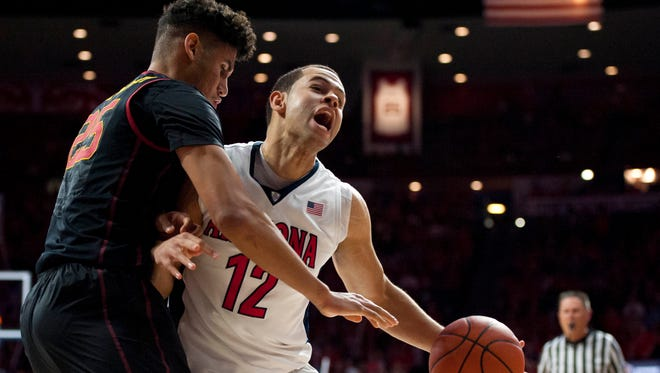 Southern California Trojans forward Bennie Boatwright (25) defends Arizona Wildcats forward Ryan Anderson (12) during the second half at McKale Center on Feb. 14, 2016.