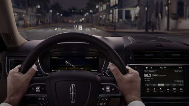 "If you're driving a Lincoln Continental, new ""heads up"" technology lets you choose which information will appear directly in your line of sight on the windshield, including your speed, distance to your destination, fuel level and who's calling on your cell phone."