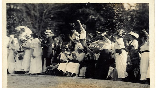 Spectators cheer at a baseball game, 1913, in a photo postcard by Paul R. Collier.