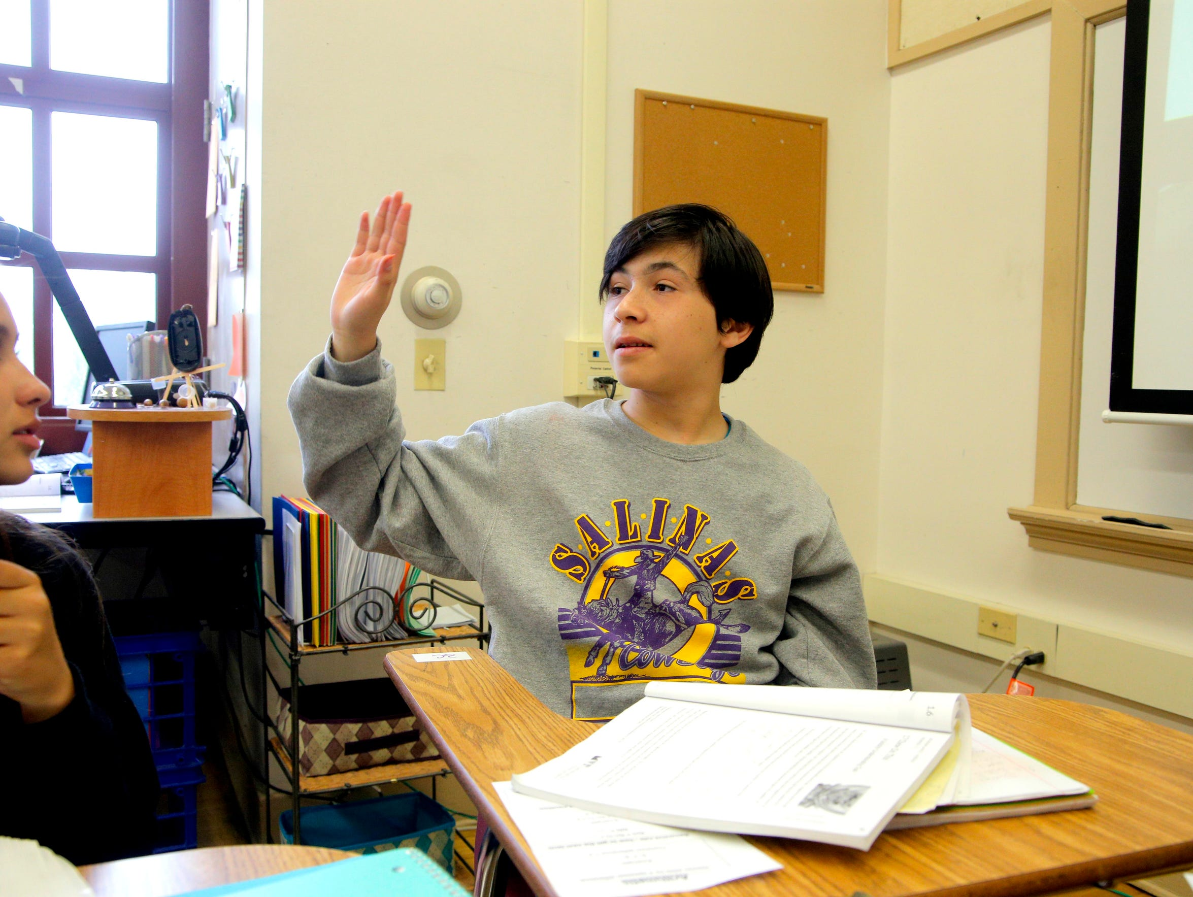 Jose Anzaldo raises his hand during math class at Salinas