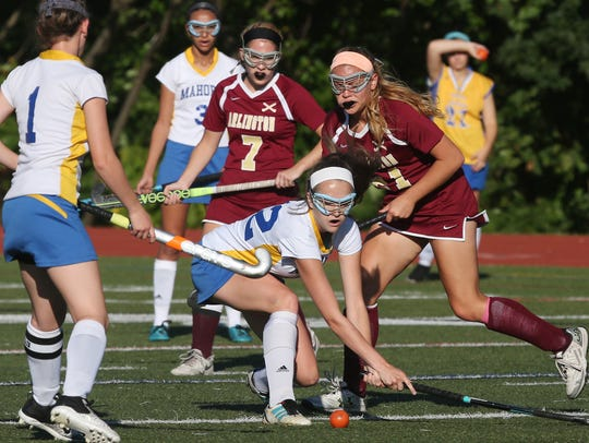 Mahopac's Erin Girven (22) and Arlington's Jordan Smith