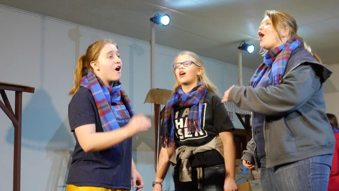 From left, Mo Wall, Molly Tingey and Kali Duncan perform warm-up exercises during a recent Belt Valley Shakespeare Players rehearsal.